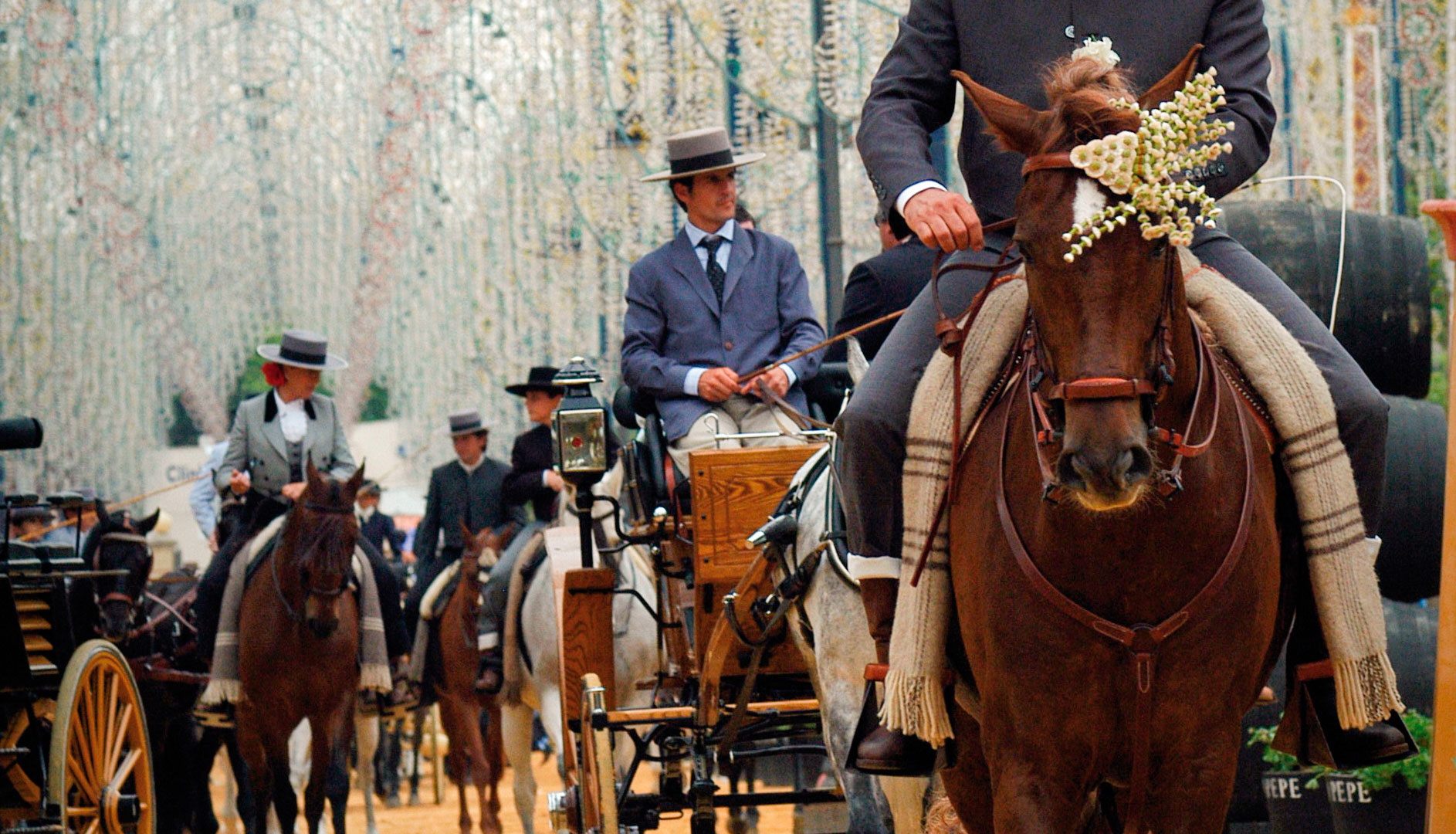 "Horses and buggies in the parade of the ""Feria de Jerez""."
